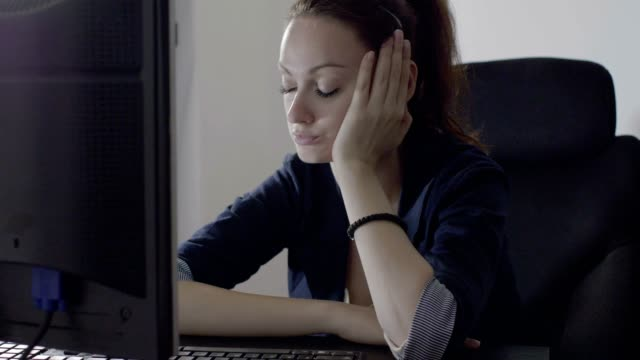 Woman working late nap video