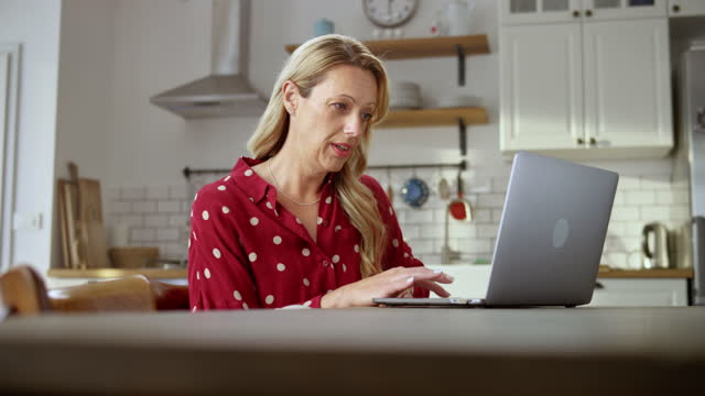 Woman working on her computer and having a videoconference call