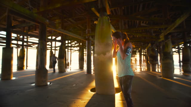 Woman Working out on Beach at Sunset. Fitness Active Lifestyle. Running on the Sand video