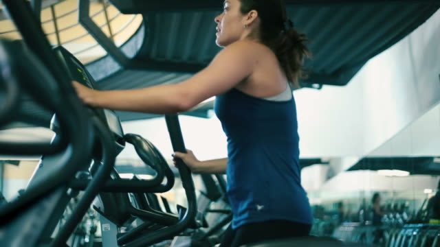 Woman working out on Elliptical Machine at Gym video