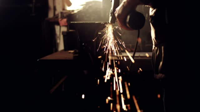 woman working with angle grinder