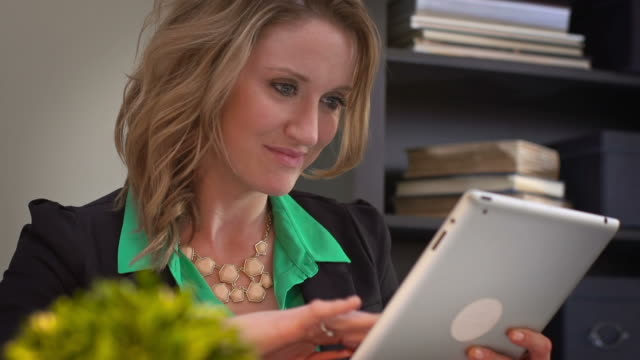 Woman works on tablet video
