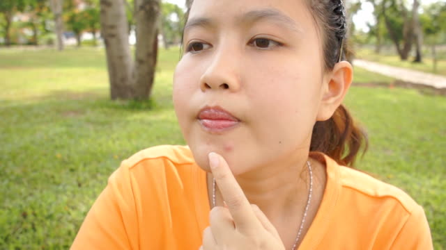 Woman worry about her pimple. video