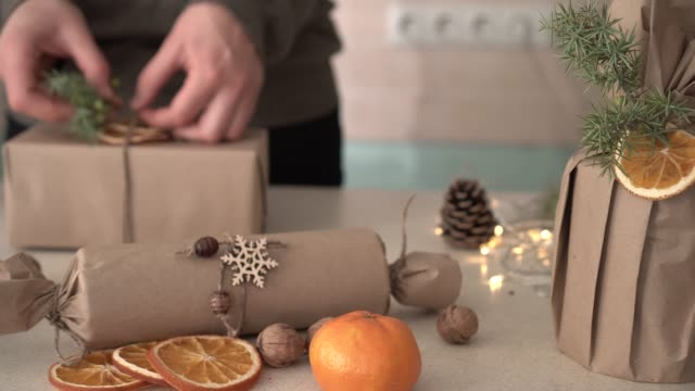 Woman wrapped a gift by using recycled or all-natural and compostable materials Zero Waste Eco Friendly Gift Wrapping. Woman wrapped a gift by using recycled or all-natural and compostable materials wrapped stock videos & royalty-free footage