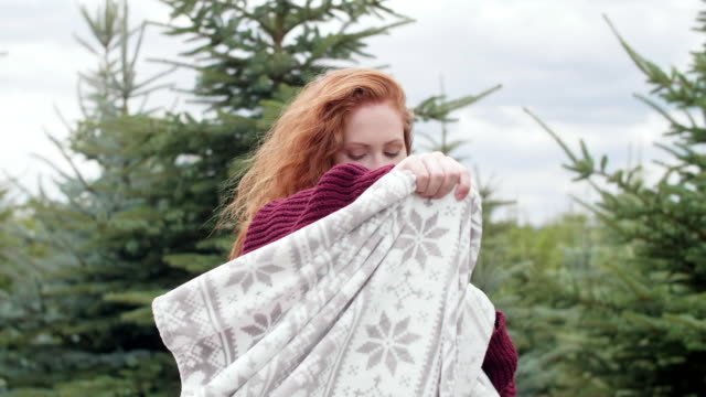 Woman wrapped in blanket outdoors Woman wrapped in blanket outdoors blanket stock videos & royalty-free footage