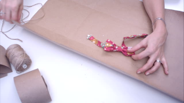 Woman wrapping a bowtie video