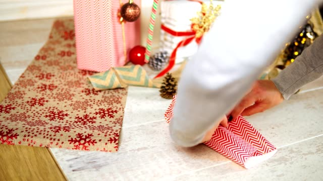 Woman wrapping Christmas present video
