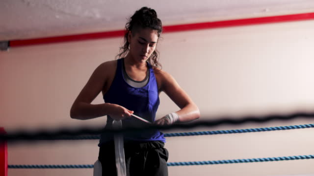 Woman Wrapping Hands Before Sparring video