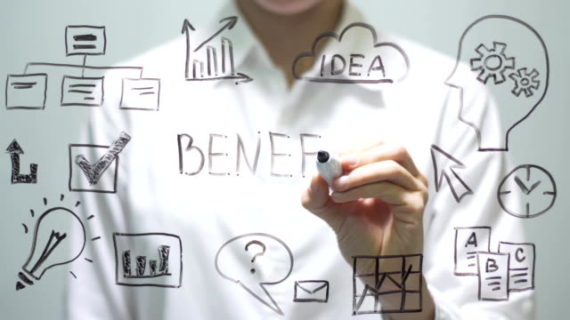 woman writing benefit on transparent screen. businesswoman write on board - indennità video stock e b–roll