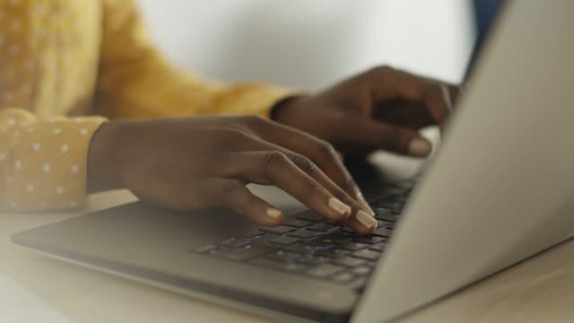 Woman writing e-mail