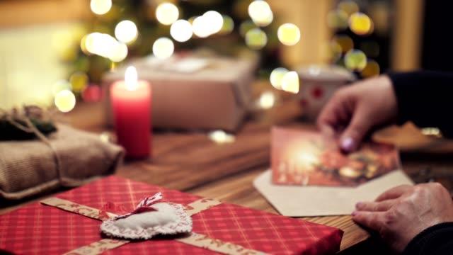 Woman Writing Greeting Christmas Postcard.