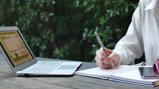 woman writing in the note - to do list video stock e b–roll
