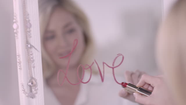 Woman writing with lipstick video