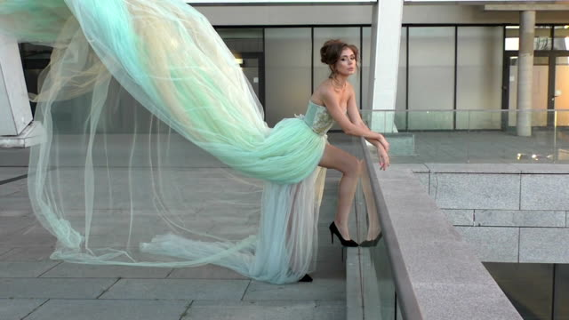 Woman's dress is blowing the wind. video