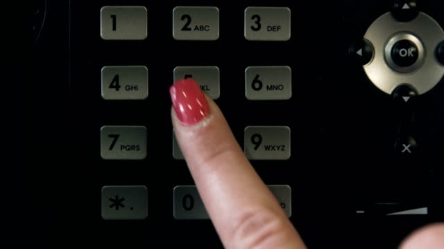 Woman's Finger Pressing Numbers on a Stationary Phone video