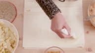 istock woman's hand brushing filo pastry with melted butter shot from above 1195390818
