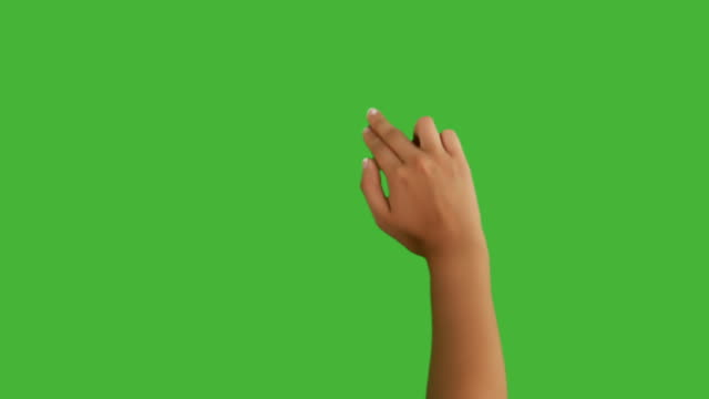 Woman's hand doing touchscreen gestures on green video