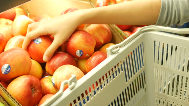Woman's hand shopping in supermarket , select apple video