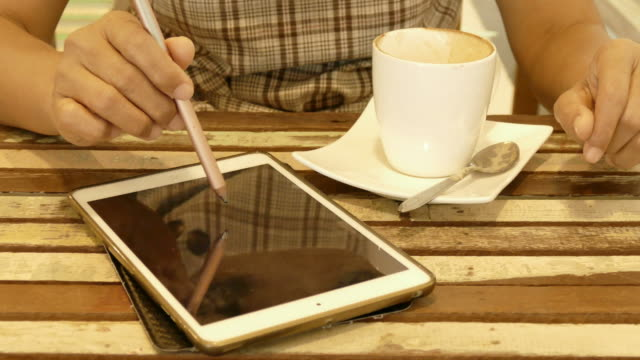Woman's hand using tablet and smart phone video