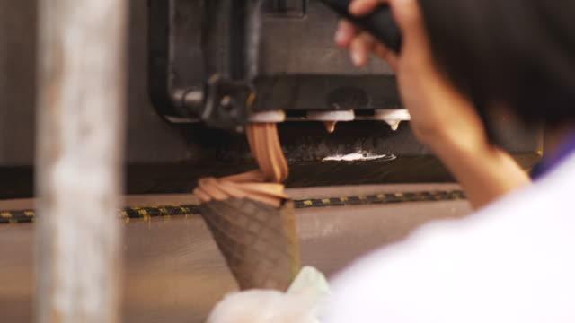 woman's hand with ice-cream cone process-video stock - ice cream video stock e b–roll