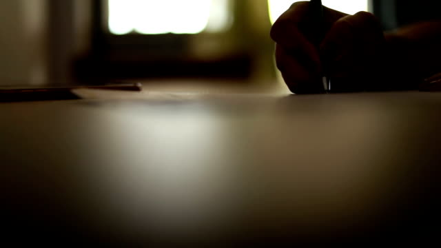 woman's hand writing a signature video