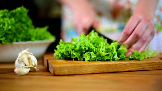 Woman's hands cutting lettuce video