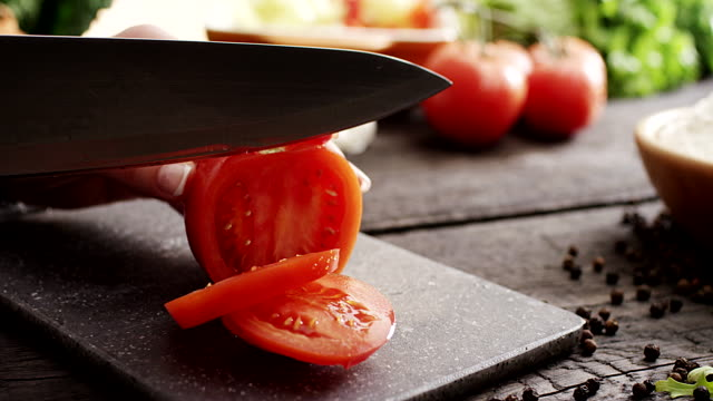 Woman's hands cutting tomato video
