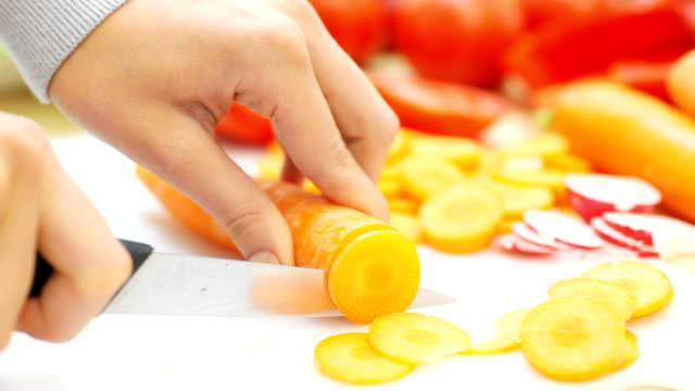 Woman's hands cutting vegetables. video