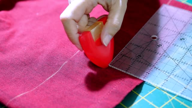 woman's hands, doing her patchwork - sarta video stock e b–roll