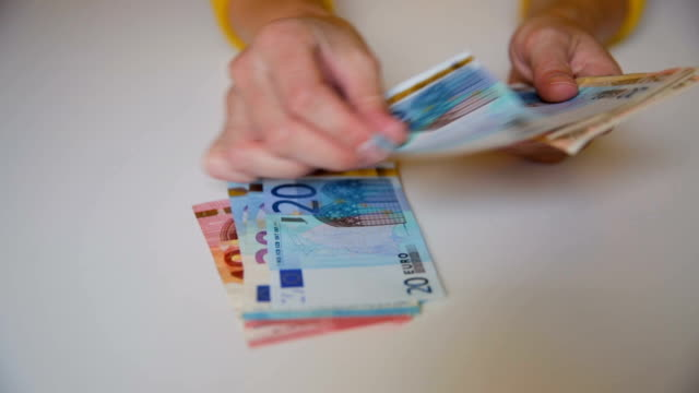 woman's hands holding and counting european euro bills. wealth, cash, money concept - valuta dell'unione europea video stock e b–roll
