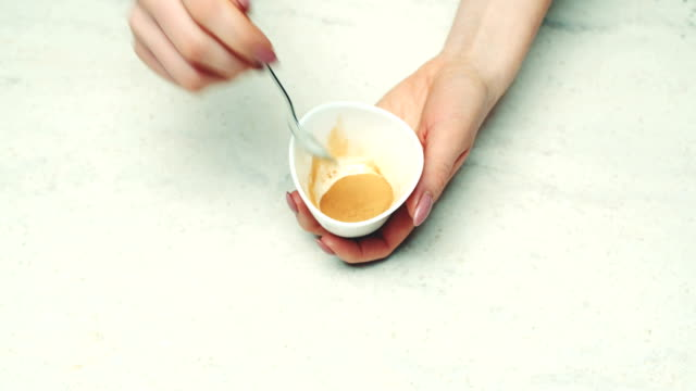 Woman'S Hands Holding Bowl Of Ground Cinnamon video