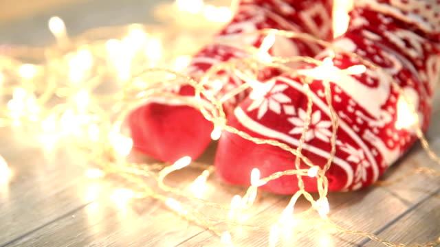Woman's legs in seasonal winter socks by th Christmas decoration Woman's legs in seasonal winter socks by th Christmas decoration sock stock videos & royalty-free footage