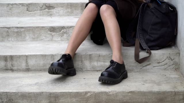 Woman's legs tapping a rhythm Woman's legs in black boots tapping a rhythm on the stairs stamping feet stock videos & royalty-free footage