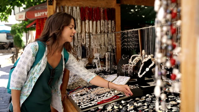 woman's stuff-buying jewelry on vacation woman's stuff-buying jewelry on vacation souvenir stock videos & royalty-free footage