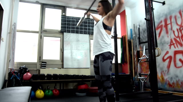 Women and Weightlifting Young woman weightlifting at the gym,healthy lifestyle concept human joint stock videos & royalty-free footage
