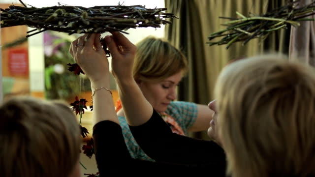 Women are making handmade decoration with flowers video