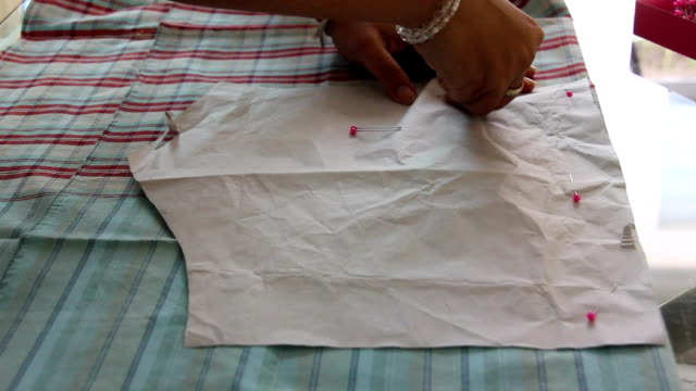 women attach pattern with cloth video