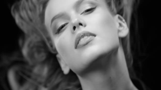 Women, Beauty, Fashion Model, Human Face. Black & White fashion video. Beautiful woman with natural make-up. Perfect fashion models face. Black & White fashion video. 4K 30fps ProRes 4444 advertisement stock videos & royalty-free footage