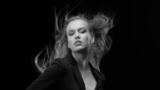 Women, Beauty, Fashion Model, Human Face. Black & White fashion video. Beautiful woman with natural make-up. Perfect fashion models face. Black & White fashion video. 4K 30fps ProRes 4444 highlights hair stock videos & royalty-free footage