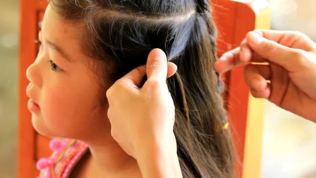 CU/women braid hairstyle in beauty salon women braid hairstyle in beauty salon highlights hair stock videos & royalty-free footage