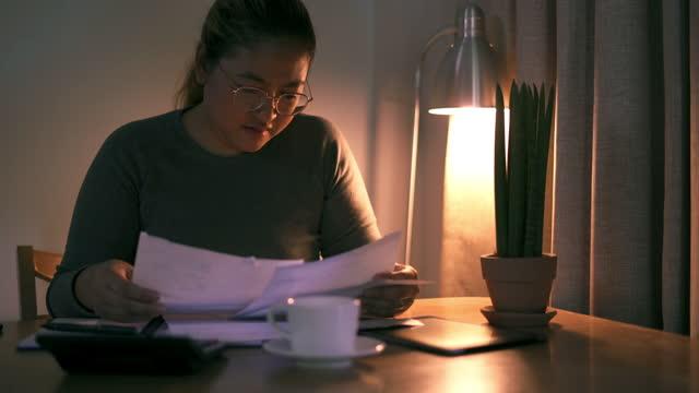 Women Checking financial bill video