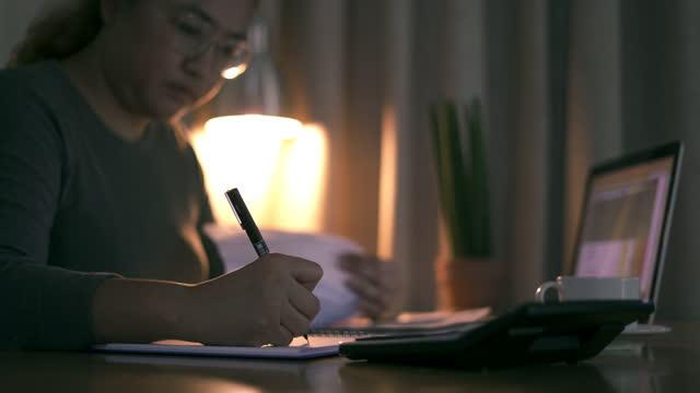 Women Checking financial documents video