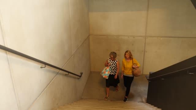 Women climbing stairs of dance class