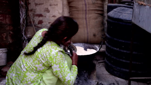 Women cooking food on mud stove video