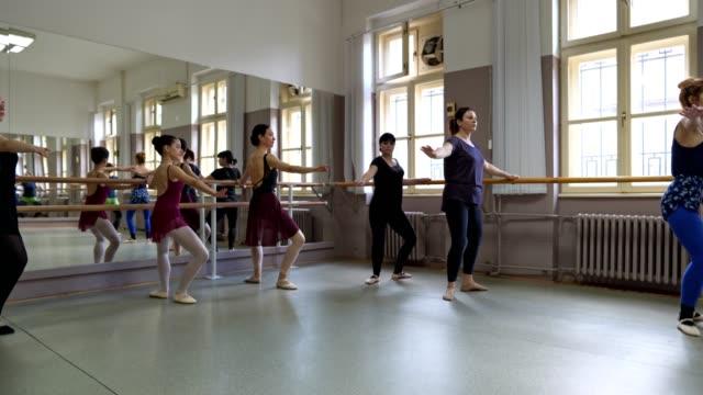 Women doing ballet practice