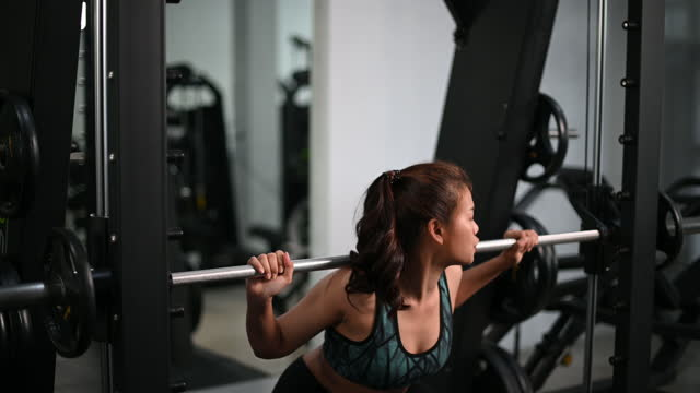 Women doing exercise and lifting weights Codio to get a beautiful bottom