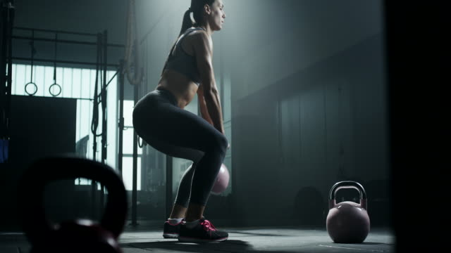 Women doing exercise with kettlebell video