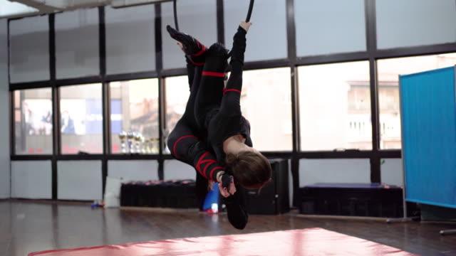 Women doing gymnastic exercises on the hoop