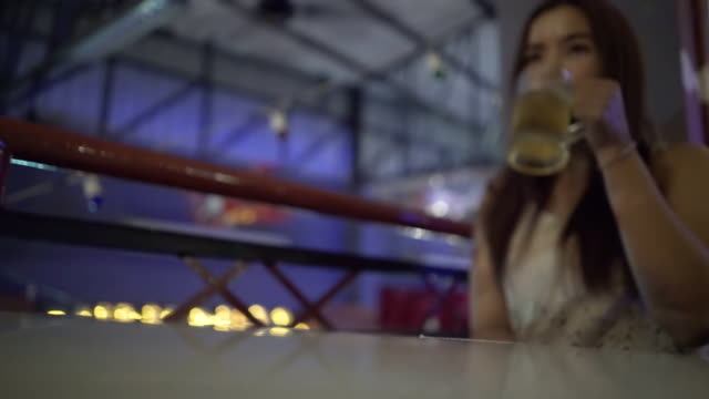 Women drinking beer and use smartphone video