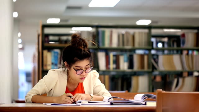 women education woman working in the library, study education campus stock videos & royalty-free footage